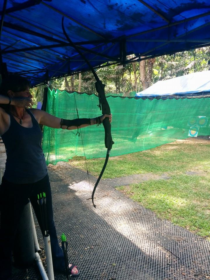Archery involves slowing your breathing to calm your mind, and allowing your fingers to let go, more than finding force