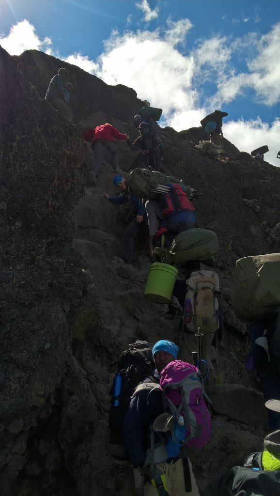 Climbing the wall.  And yes, porters ran up with their packs.